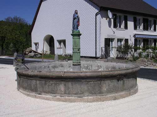 Sablage sur une fontaine ancienne